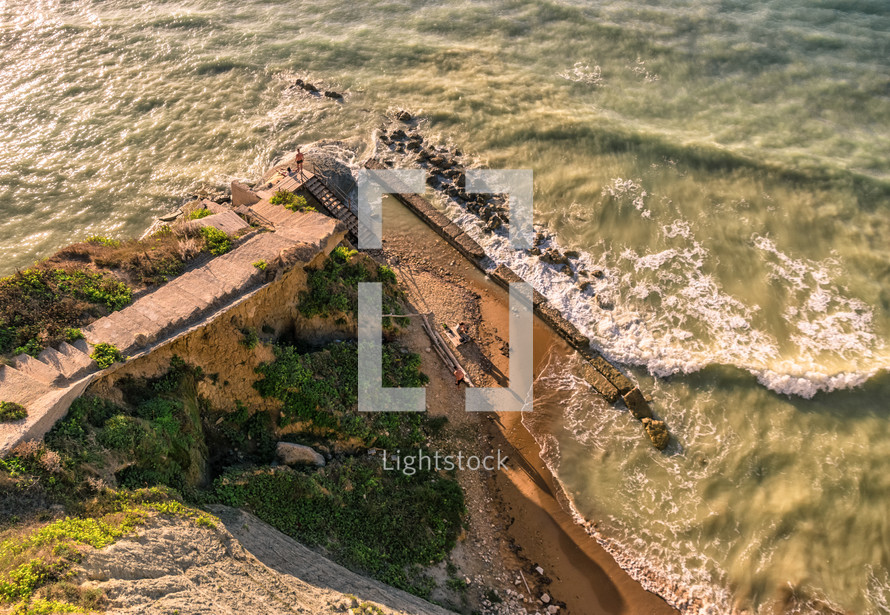 overhead of a beach shore and ocean view