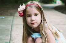 little girl wearing a headband