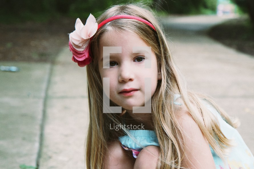 little girl wearing a headband