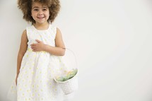 a girl child holding an Easter basket