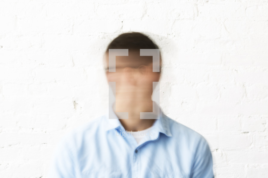 blank faced man
