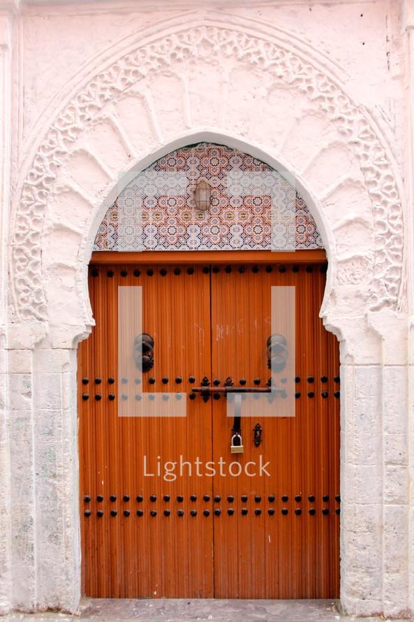 Wooden door to a mosque entrance.