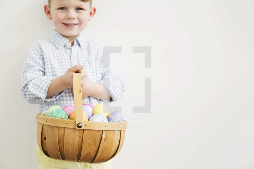 boy holding an Easter basket