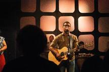 worship music, man, woman, singing, microphone, musicians