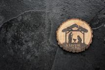 a savior is born wooden ornament