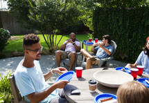 people at an outdoor cookout
