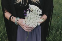 a woman holding picked white flowers