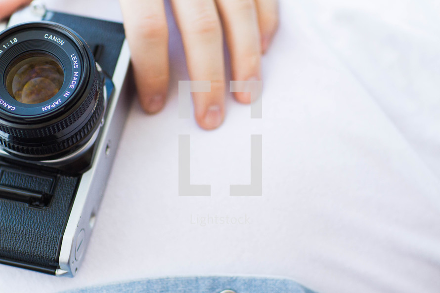 hand on a camera