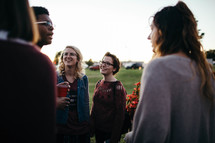young adults having conversations outdoors