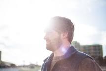 a man standing under intense sunlight