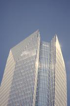 top of a skyscraper against a blue sky