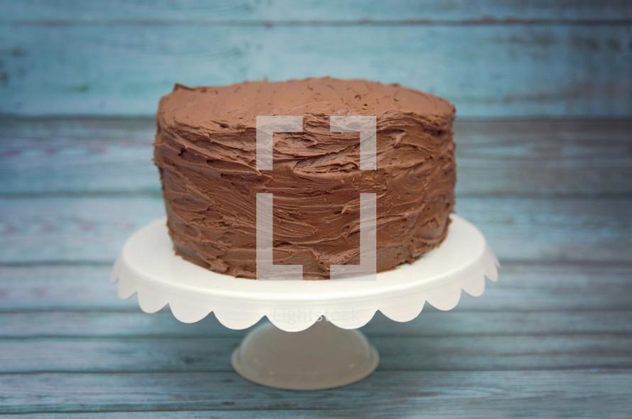 chocolate cake on a cake stand