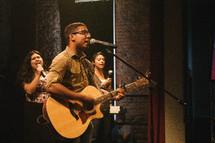 worship music, guitar playing, singing, microphone, man, woman