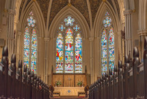 Interior of a cathedral with stained glass windows.