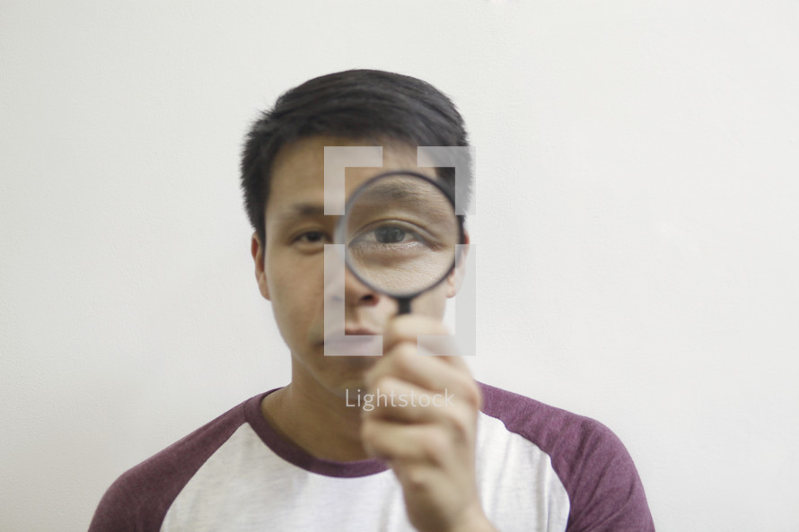 a man holding a magnifying glass