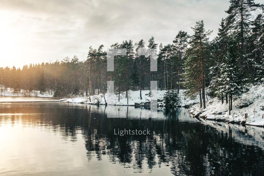 snow along a lake shore