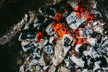 embers from a burning fire