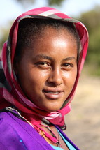 Ethiopian woman wearing a traditional head scarf
