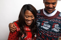 couple in ugly Christmas sweaters