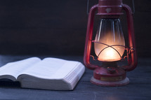open Bible and lantern