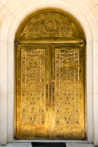 Golden church door with Albanian Orthodox church symbols