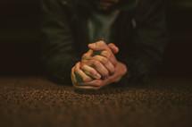a man kneeling to pray at the altar
