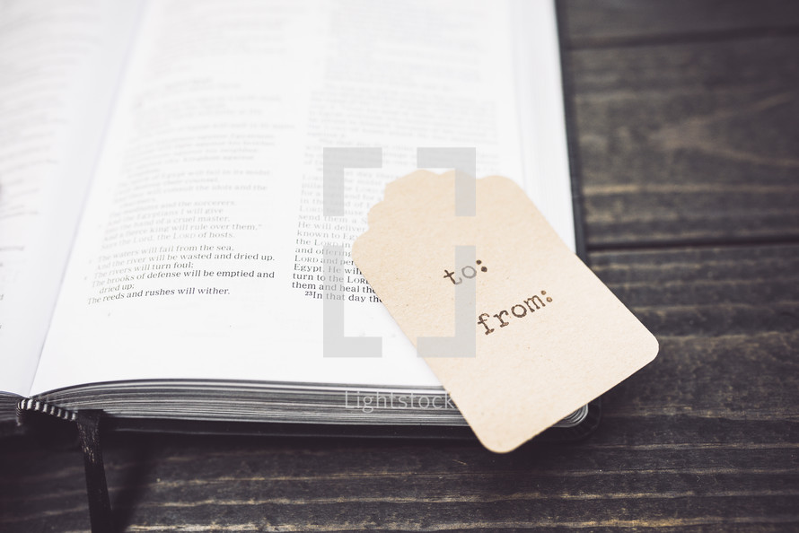 gift tag on an open Bible