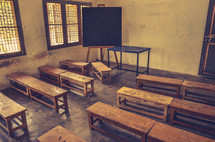 An empty classroom at an orphanage in India.