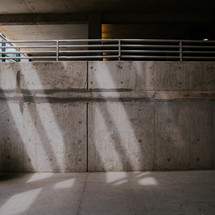 railing and concrete in a parking garage