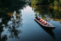 an anchored boat in the Amazon river