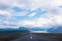 road leading to mountain and glacier