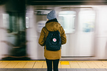 woman waiting in a subway