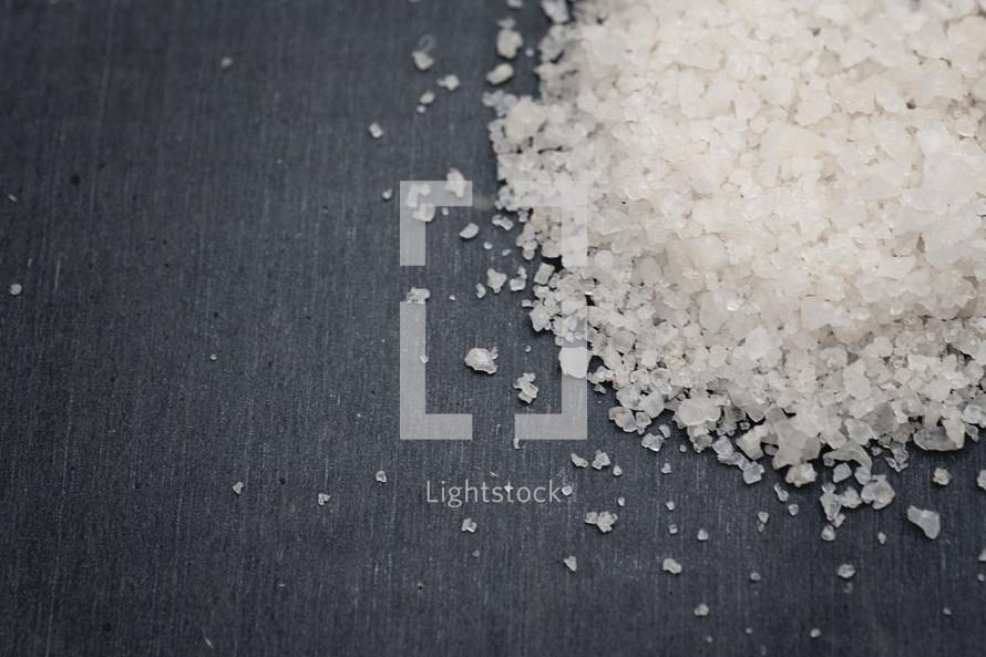 grains of salt on black background