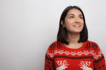Latino woman in an ugly Christmas sweater