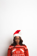 woman with a frown in a santa hat