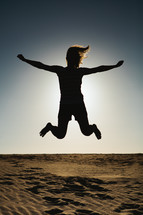 silhouette of a woman leaping in the air