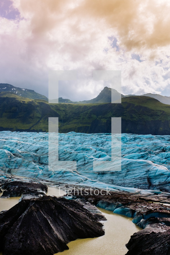 ice from a glacier and mountain peak