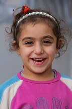 Smiling young Chaldean Iraqi refugee girl [For similar search Ethnic Face Smile]