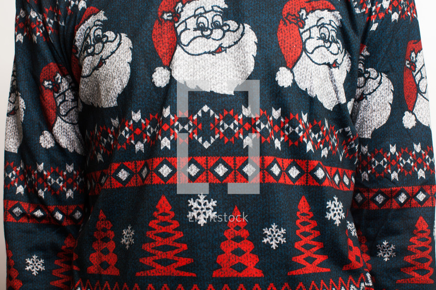man in an ugly Christmas sweater with santas