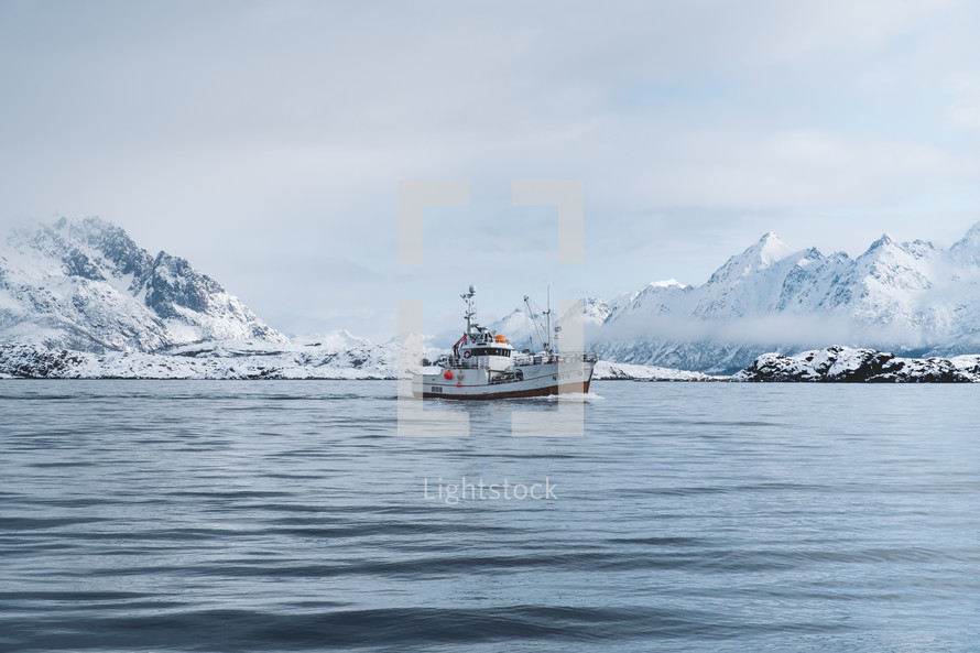 fishing boat in a winter sea