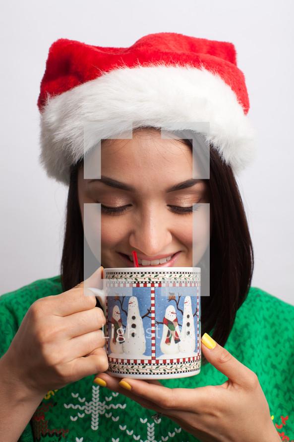 woman drinking hot cocoa at Christmas