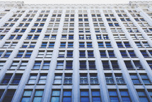 Windows in a tall office building.