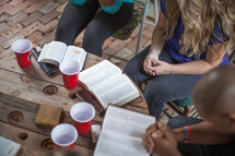 praying and reading Bibles in a small group Bible study