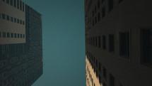 sky between city buildings