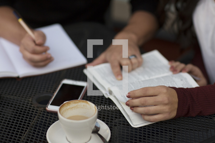 a young man and young woman reading a Bible and discussing scripture