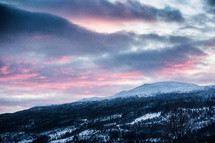 pink sky over a snowy mountain