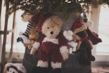Teddy bears under a Christmas tree