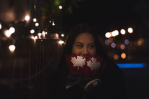 a woman wearing Canadian flag mittens