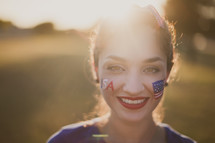 A young woman with American flag face paint