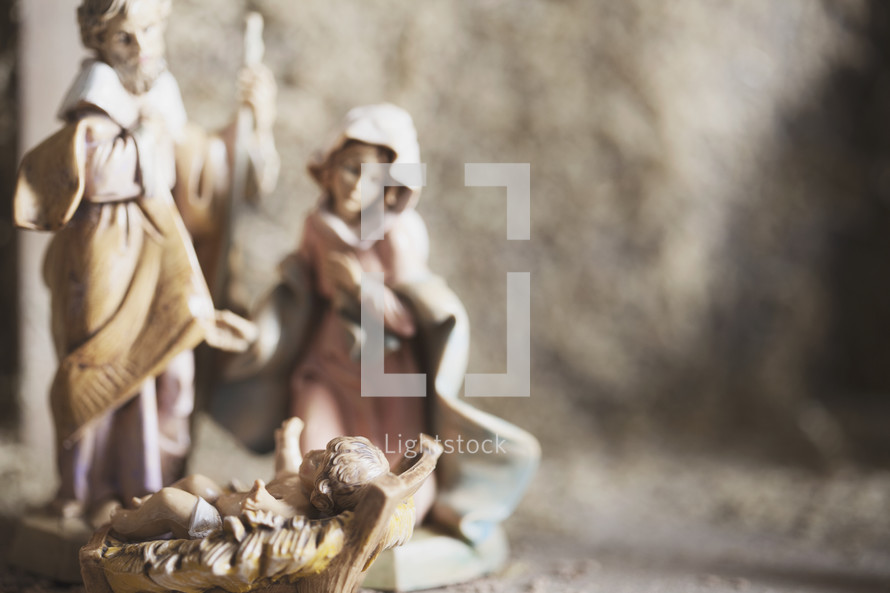 figurines of Mary and Joseph with baby Jesus.